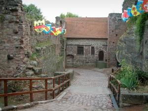 Haut-Barr castle - Entrance to the fortress decorated with shield flags