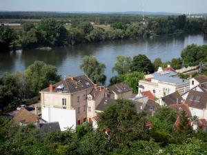 Herblay - View of the Seine valley, with the houses of the town of Herblay and River Seine lined with trees