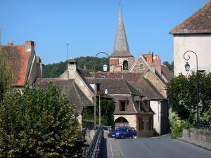 Hérisson - View of the Saint-Sauveur bell tower and houses of the medieval village from the Aumance bridge