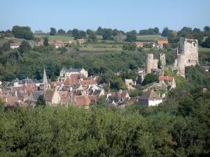 Hérisson - View of the Hérisson village surrounded by greenery: houses of the medieval village, Saint-Sauveur bell tower, Notre-Dame church and medieval castle dominating the place