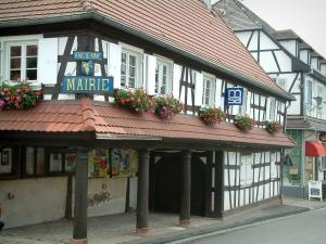 Hoffen - White half-timbered house (town hall) with and three wooden pillars