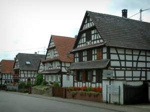 Hoffen - White Half-timbered houses and flower gardens