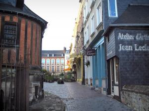 Honfleur - Narrow street leading to the Sainte-Catherine square, Sainte-Catherine church, houses and shops