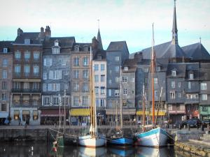 Honfleur - Sailboats in the Vieux Basin pond (port), tall houses of the Sainte-Catherine quay, and Sainte-Catherine church in background