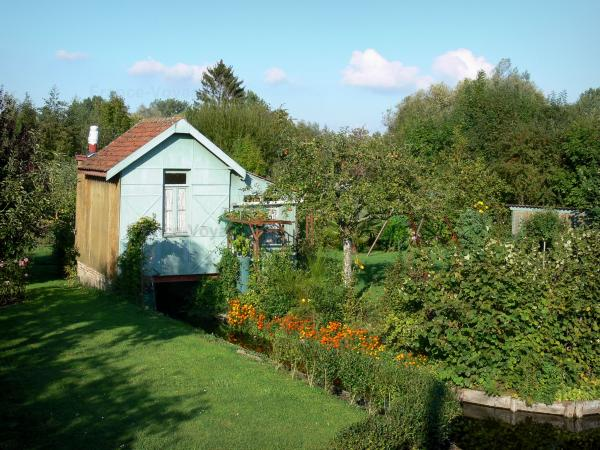 Hortillonnages of Amiens gardens - Hut and gardens along the water (canal)