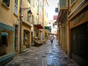 Hyères - Massillon street with houses with colourful facades, its shops and its displays