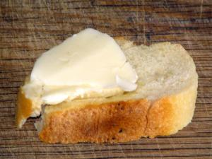 Isigny dairy products - Piece of butter on a slice of bread