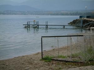 Lake Geneva - Beach with fishing material, lake, pontoon and shore in background