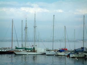 Lake Geneva - Sailboats in the Évian-les-Bains port and lake