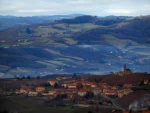 Landscapes - Houses of a village in in the Pierres Dorées (golden stones) area, and hills