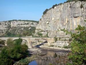 Landscapes of the Ardèche - Balazuc bridge spanning River Ardèche and cliffs overlooking the place