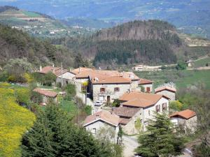 Landscapes of the Ardèche - Stone houses in a wooded setting
