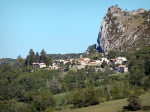 Landscapes of Ariège - Village of Roquefixade surrounded by trees and situated at the foot of the Roquefixade Cathar castle (remains) perched on its rocky outcrop (pog)