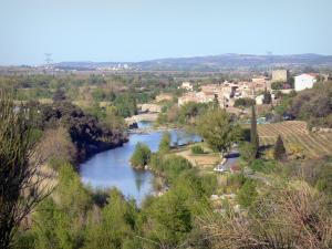 Landscapes of the Aude - View of the village of Ribaute and bridge over River Orbieu in a wooded setting
