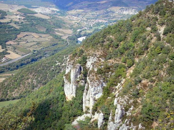 Landscapes of Aveyron - Grands Causses Regional Nature Park: cliffs in the foreground with a view on the Tarn valley