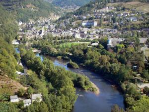 Landscapes of Aveyron - View of the Entraygues-sur-Truyère town and its castle at the confluence of Rivers Lot and Truyère, in a green setting