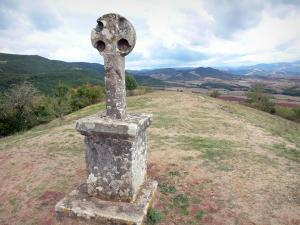 Landscapes of Aveyron - Rougier de Camarès, in the Grands Causses Regional Nature Park: old cross (town of Gissac) with its panorama