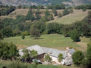 Landscapes of Aveyron - Farmhouse surrounded by trees and meadows
