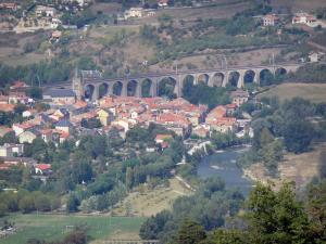 Landscapes of Aveyron - Tarn valley: view of the church bell tower, the roofs of the village, and the Aguessac viaduct
