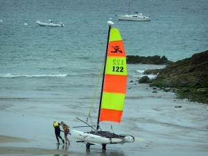 Landscapes of the Brittany coast - Emerald Coast: catamaran, sandy beach, rock, boats on the sea, in Saint-Lunaire