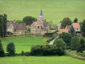 Landscapes of Burgundy - Bazoches village with its Saint-Hilaire church and houses surrounded by trees and meadows