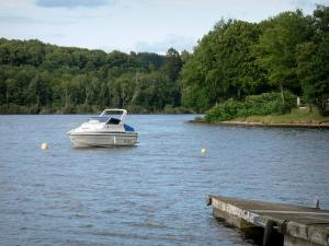 Landscapes of Burgundy - Settons lake (artificial lake), in the Morvan Regional Nature Park: boat on the lake and wooded banks