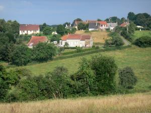 Landscapes of Burgundy - Houses surrounded by trees and meadows