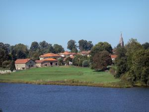 Landscapes of the Charente - Mas Chaban lake (lakes of the Upper Charente), meadows, bell tower, houses and trees