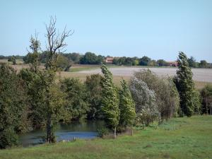 Landscapes of the Charente - Trees along the water, prairie, fields and houses