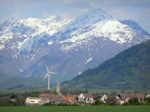 Landscapes of Dauphiné - Trièves: village, wind, pasture, forest and snow-capped mountains