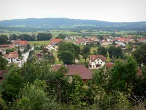 Landscapes of the Doubs - Houses of the village of Goux-les-Usiers surrounded by trees and prairies