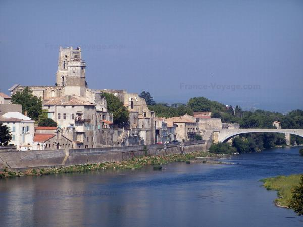 Landscapes of the Gard - Bell tower of the Saint-Saturnin, bell tower of the Saint-Pierre priory and houses in the town of Pont-Saint-Esprit, bridge spanning the River Rhone