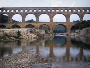 Landscapes of the Gard - Pont du Gard bridge: Roman aqueduct (ancient monument) with three levels of arcades (arches) spanning the Gardon River, in the town of Vers-Pont-du-Gard