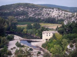 Landscapes of the Gard - Cèze valley: River Cèze, mill, trees at the edge of the water and hills