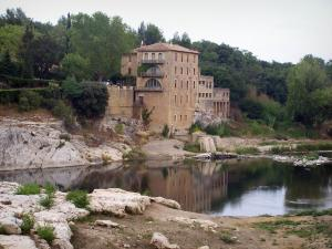Landscapes of the Gard - Old mill dominating the River Gardon, near the Pont du Gard bridge; in the town of Vers-Pont-du-Gard
