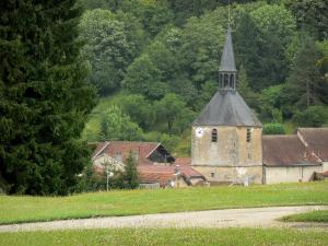 Landscapes of the Haute-Marne - Bell tower of the Saint-Pierre-ès-Liens church and roofs of houses in the village of Cirey-sur-Blaise surrounded by greenery, in the Blaise valley