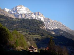 Landscapes of the Hautes-Alpes - Dévoluy mountain range: houses, trees and mountain