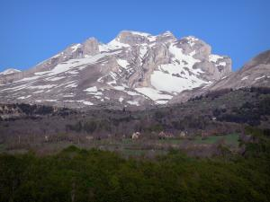 Landscapes of the Hautes-Alpes - Dévoluy Massif of: forest, houses, prairies, trees and mountain dotted with snow