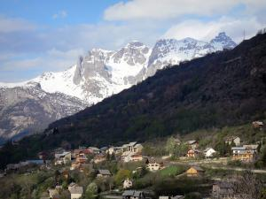 Landscapes of the Hautes-Alpes - Chalets, trees and mountain dotted with snow, in Briançon