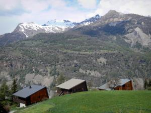 Landscapes of the Hautes-Alpes - Chalets with view of the mountain