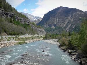 Landscapes of the Hautes-Alpes - River lined with trees and mountains