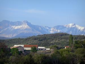 Landscapes of the Hautes-Alpes - Farm surrounded by trees and mountains