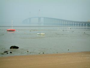 Landscapes of the Loire-Atlantique coast - Boats at ebb tide and the Saint-Nazaire bridge