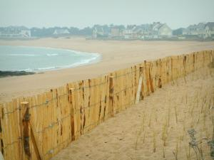 Landscapes of the Loire-Atlantique coast - Sand, fence, beach, the sea (Atlantic Ocean) and houses
