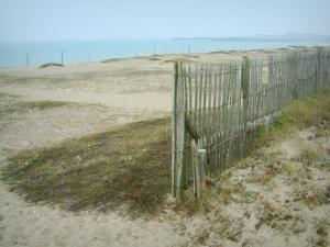 Landscapes of the Loire-Atlantique coast - Fence, grass, sand, beach, the sea (Atlantic Ocean) and coast
