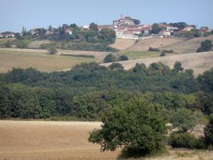 Landscapes of the Lot-et-Garonne - Moirax village with its church and houses, surrounded by fields and trees