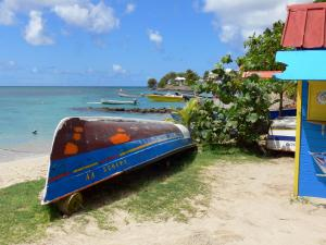 Landscapes of Martinique - Fishing boats and colored boxes of Sainte-Luce waterfront