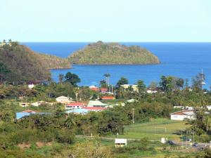 Landscapes of Martinique - Houses along the sea, overlooking the cove at the Donkey and the islet to Ramiers; in the town of Trois-Îlets