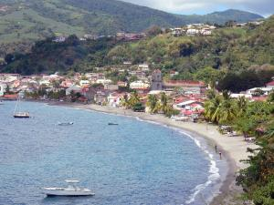 Landscapes of Martinique - Overlooking the bay of St. Peter, with the towers of the Cathedral of Our Lady of the Assumption, the beach and the houses of the city on the Caribbean Sea