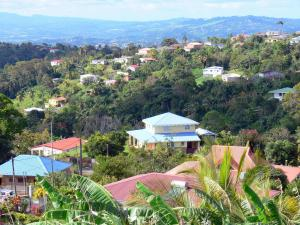 Landscapes of Martinique - Regional Park of Martinique: green landscape dotted with houses
